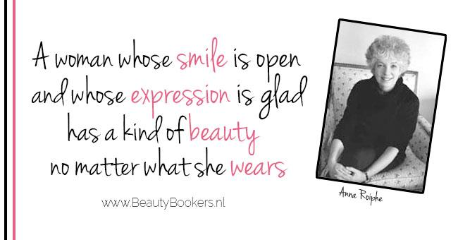 A woman whose smile is open